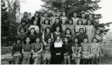 Older elementary school girls with Franciscan sister, 1940