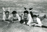 High school boys laying on grass, n.d.