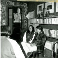 High school girls meeting by books, 1976