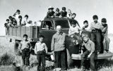 Boys and Jesuit brother with potato-filled truck, n.d.
