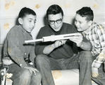 Brothers with slide rule, n.d.