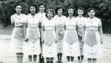 Older girls in matching dresses and aprons, n.d.