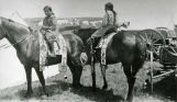 Two girls on horseback, n.d.