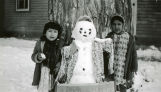 Snow man between two girls, n.d.