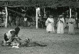 Fools Crow prepares to pierce sun dancer, 1967