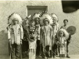 Boys in war bonnets and chiefs' costumes, n.d.