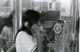 Agnes Randall with pay telephone, 1971