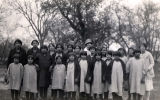 Girl students with volunteer catechists, 1927