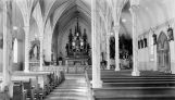 Interior of Holy Rosary church with Christmas adornment, 1937