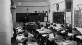 Middle-level class with Jesuit teacher, 1940