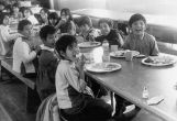 Children eating in cafeteria, n.d.
