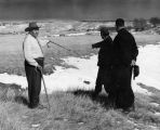 Elders at massacre site with Fr. Edwards, S.J., 1 of 3, n.d.