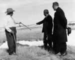Elders at massacre site with Fr. Edwards, S.J., 2 of 3, n.d.