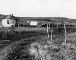 Frame cabin and wall tent, n.d.