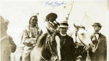 Red Hawk on horseback and in beaded buckskin shirt with unidentified men, n.d.