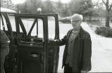 Brother George Schwieder, S.J. holding car door, n.d.