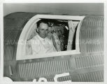 Father Scott, S.J., in Mercury space capsule, 1962