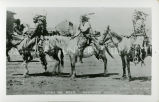 Stinking Bear mounted in war bonnet with trailer and two other men, also mounted, n.d.