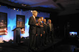 John Kerry, Dennis Kucinich, John Edwards, Al Sharpton and Howard Dean on stage after the...
