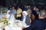 Mother Teresa seated at a luncheon held in her honor, 1981