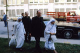 Marquette University President Rev. John P. Raynor, S.J. and Rev. Bruce Biever, S.J. escort Mother...