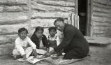 Black Elk teaching Broken Nose's children with Lacombe's ladder, 1927 or 1928