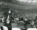 Peter A. Brooks, S.J., gives a speech before an assembly of Marquette University students, circa...