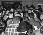 John F. Kennedy standing amid a crowd of students, 1959
