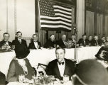 Dignitaries sit at the head table at Albert Fox's farewell banquet, January 30, 1928
