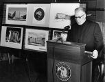 Edward J. O'Donnell, S.J., stands at a podium during a press conference announcing the Marquette...