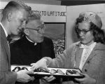 Edward J. O'Donnell, S.J., talks with science fair winners John Schmidt and Claudia Jacobson, 1955