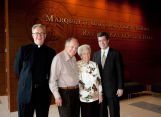 Robert A. Wild, S.J., and Joseph Kearney pose with Ray and Kay Eckstein, 2010