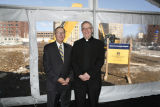 Stanley Jaskolski and Robert A. Wild, S.J., pose during groundbreaking ceremonies for the new...