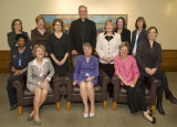 Robert A. Wild, S.J., poses with women who hold leadership positions throughout the university,...