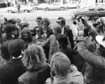 Jimmy Carter stands amid a crowd on Wisconsin Avenue, 1976
