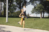 Kathleen Webb runs cross-country race, 1981-1984