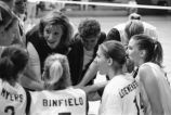 Coach Catherine (Tat) Shiley and Assistant Coach Angela Salvatore motivate team during huddle, 1996