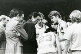 Al McGuire coaches his team in a huddle, 1975