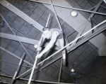 Ed Hoyle pole vaulting indoors, 1958