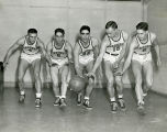 Gene Berce with four basketball teammates, 1945