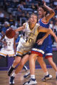 Lisa (Oldenburg) Kanning moves the ball down the court, 1996? - 1999?