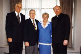 Bill Cords poses with Jim and Ginny Wheeler and Reverend Albert J. DiUlio, S.J, 1992? - 1996?
