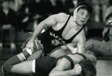 Bill Kumprey takes down an opponent, 1989
