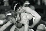 Bill Kumprey takes on opponent during wrestling match, 1989