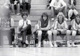"Catherine ""Tat"" Shiey sits on the sidelines, 1984"