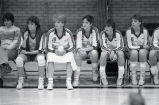 "Catherine ""Tat"" Shiely sits with members of the volleyball team, 1984"