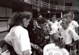 "Catherine ""Tat"" Shiely coaching in a volleyball team huddle, 1994"