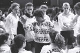 "Catherine ""Tat"" Shiely speaks to the volleyball team, 1993"