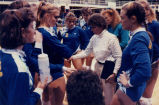 "Catherine ""Tat"" Shiely motivates the volleyball team, 1990"