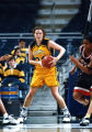 Abbie Willenborg looks to pass the basketball, 1996 - 1997